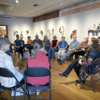 Leni talks to a gallery group at the Grants Pass Museum of Art